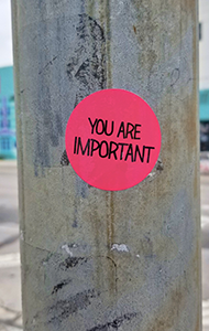 A sticker on a utility pole reads You Are Important