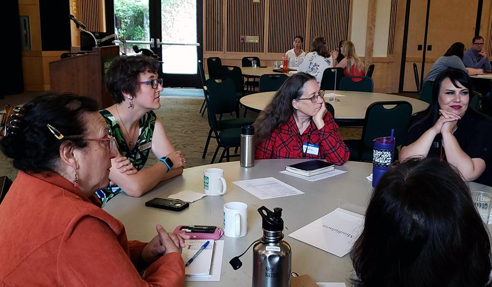 Participants discussing topics at Fall PD Day